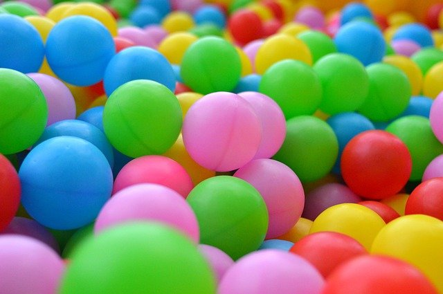 Lots of multi-coloured ping pong balls
