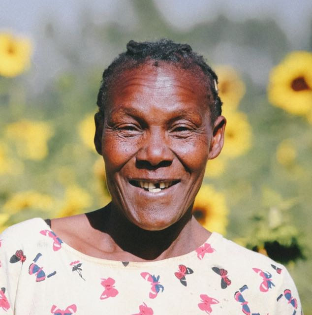 African woman smiling  Image by Tri Le from Pixabay
